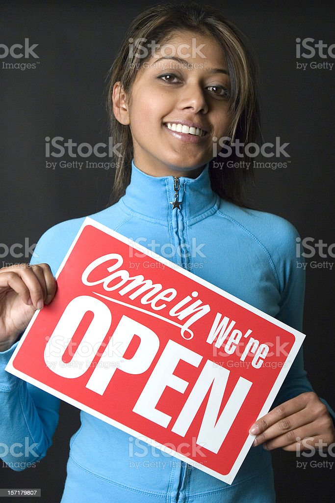 Woman holding an Open sign royalty-free stock photo