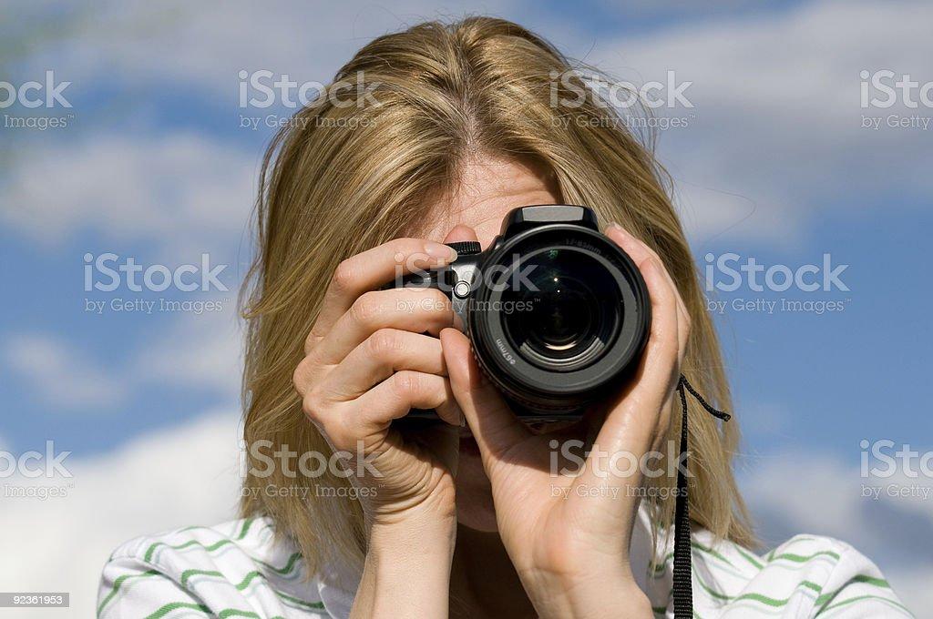 Woman Holding an SLR Camera stock photo