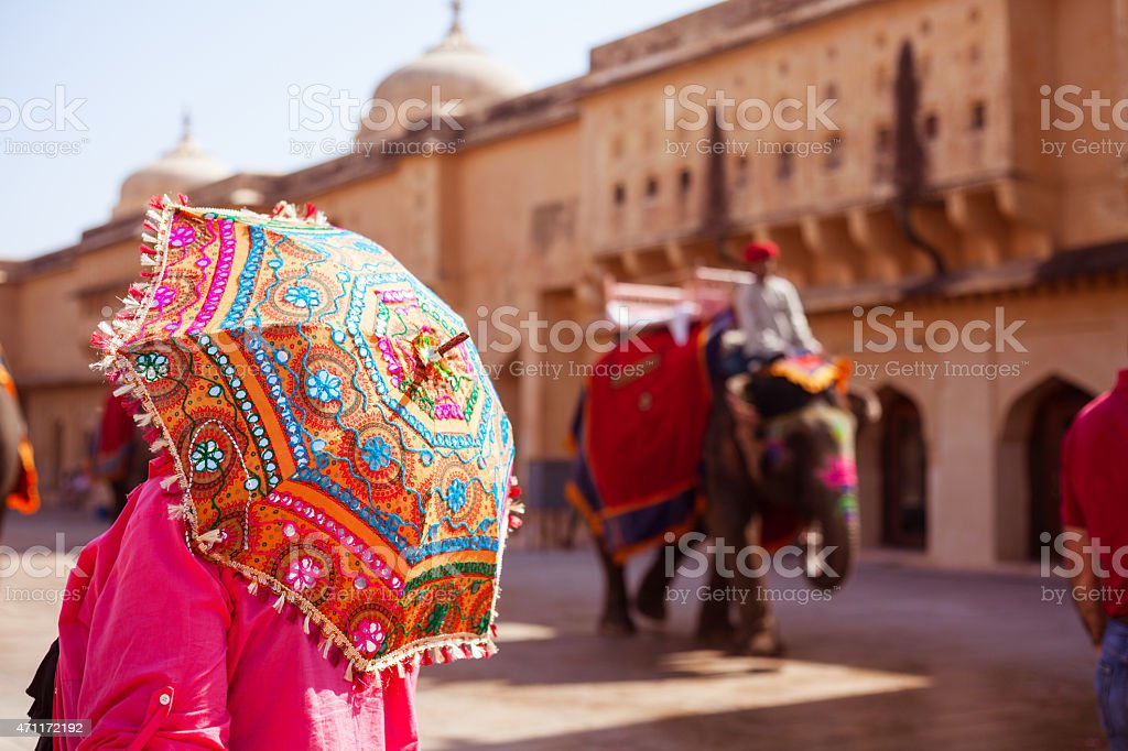 Woman holding an umbrella in Amber Fort, Jaipur, India stock photo