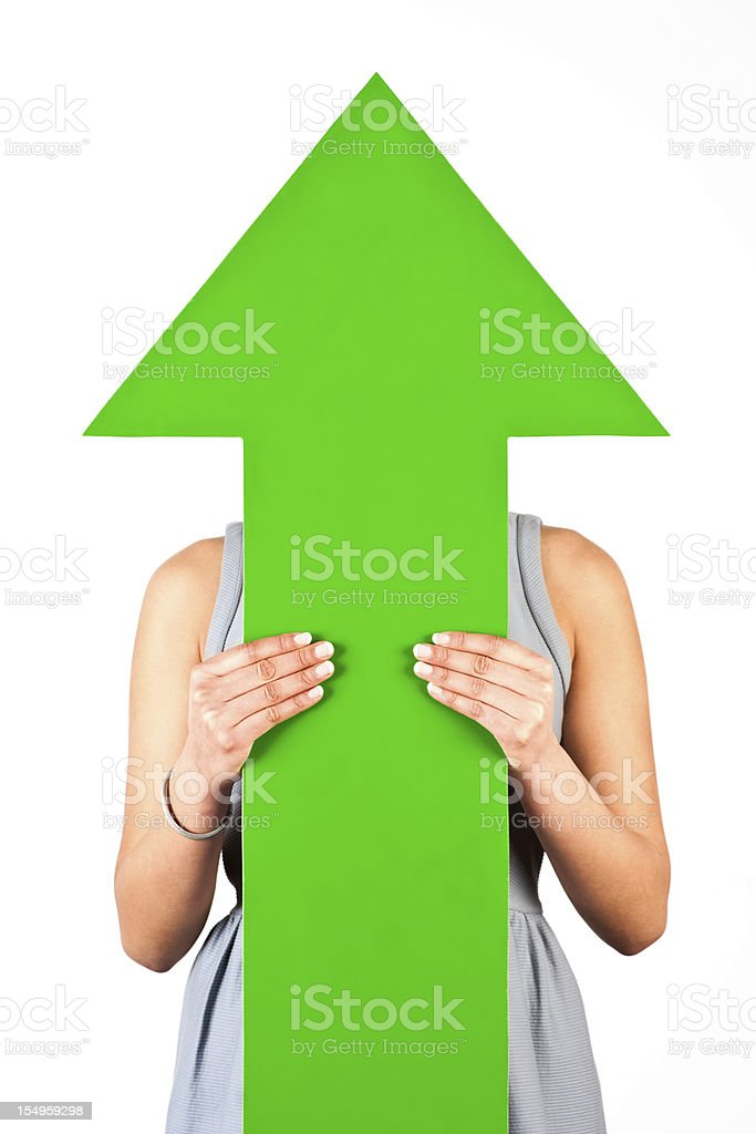 Woman holding arrow pointing up royalty-free stock photo