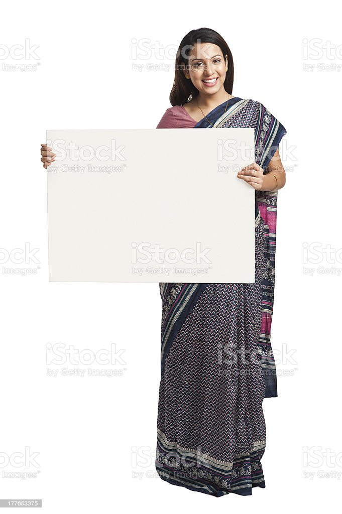 Woman holding at a whiteboard and smiling royalty-free stock photo