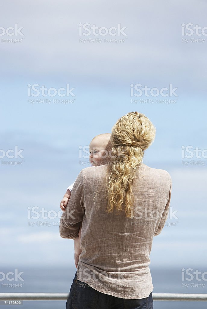 Woman holding baby outdoors royalty-free stock photo