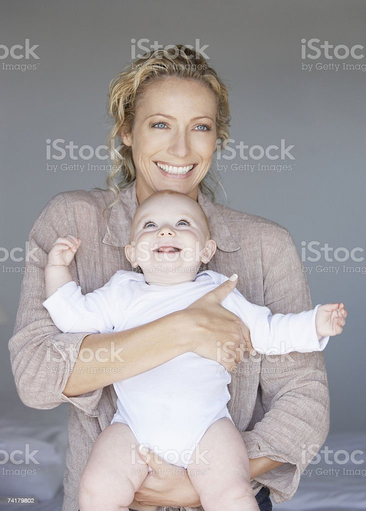 Woman holding baby royalty-free stock photo