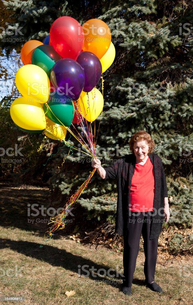 Woman holding balloons stock photo