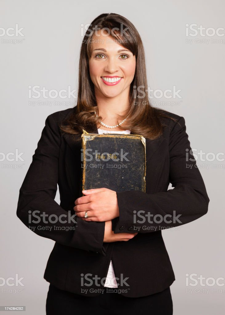 Woman Holding Bible stock photo