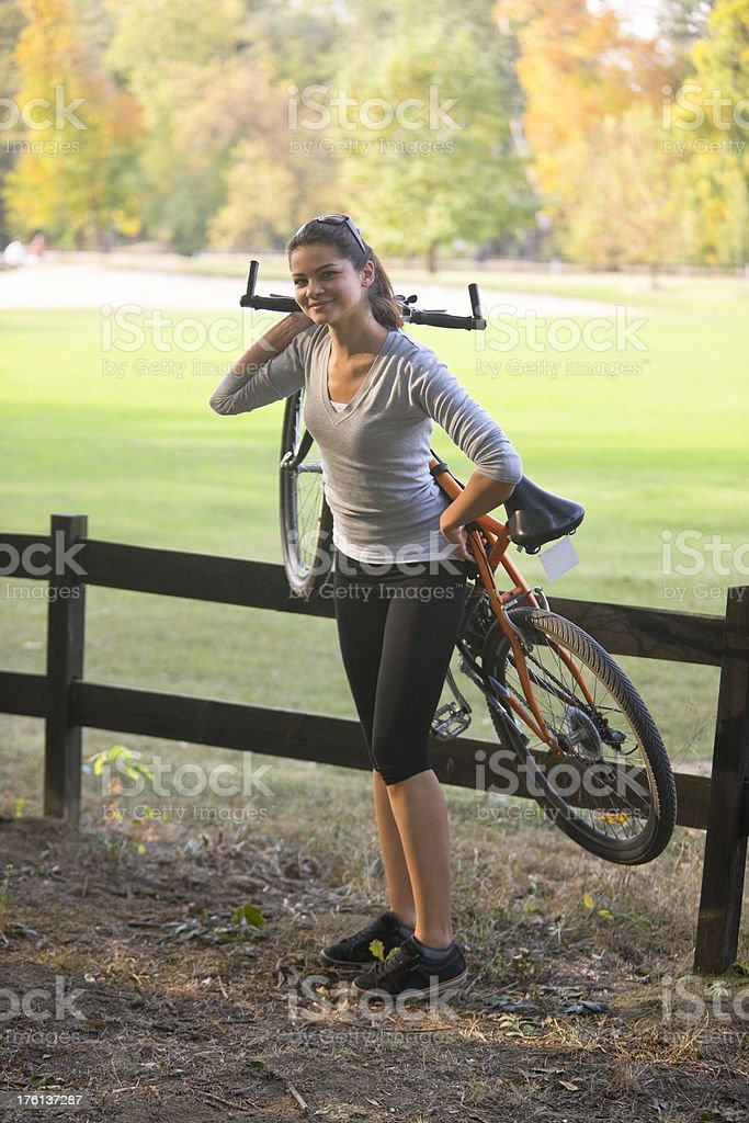 Woman holding bicycle royalty-free stock photo