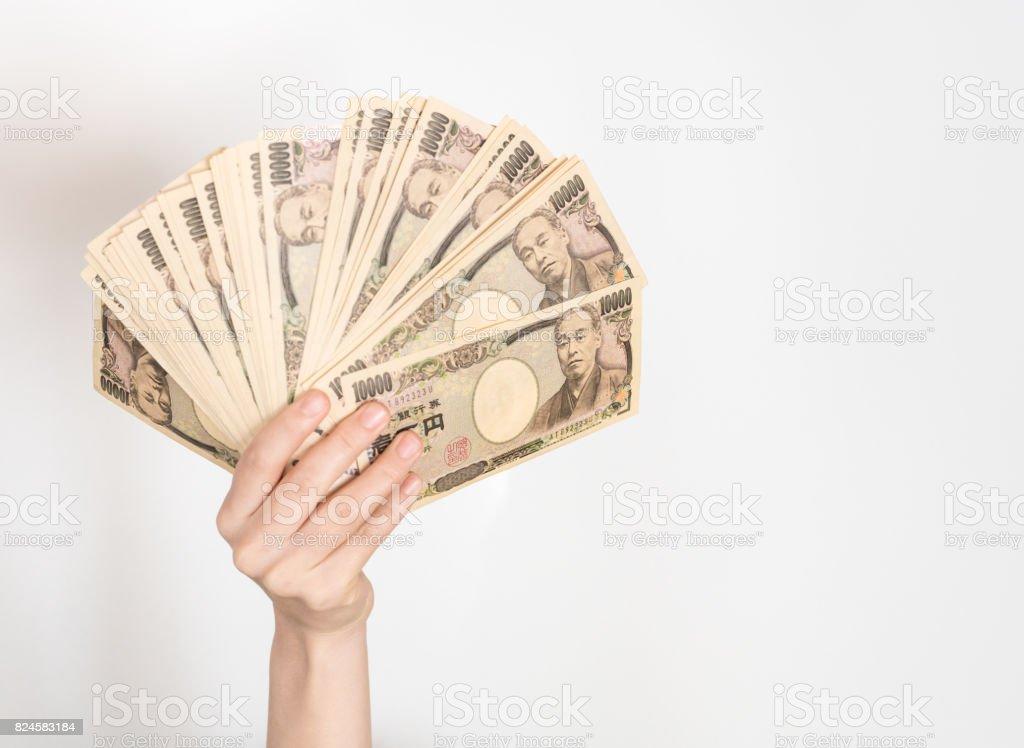 Woman holding big money stock photo