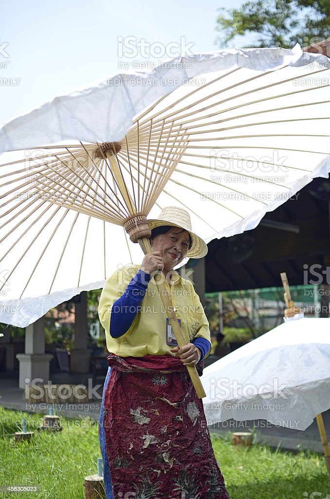 Woman holding big white umbrella royalty-free stock photo