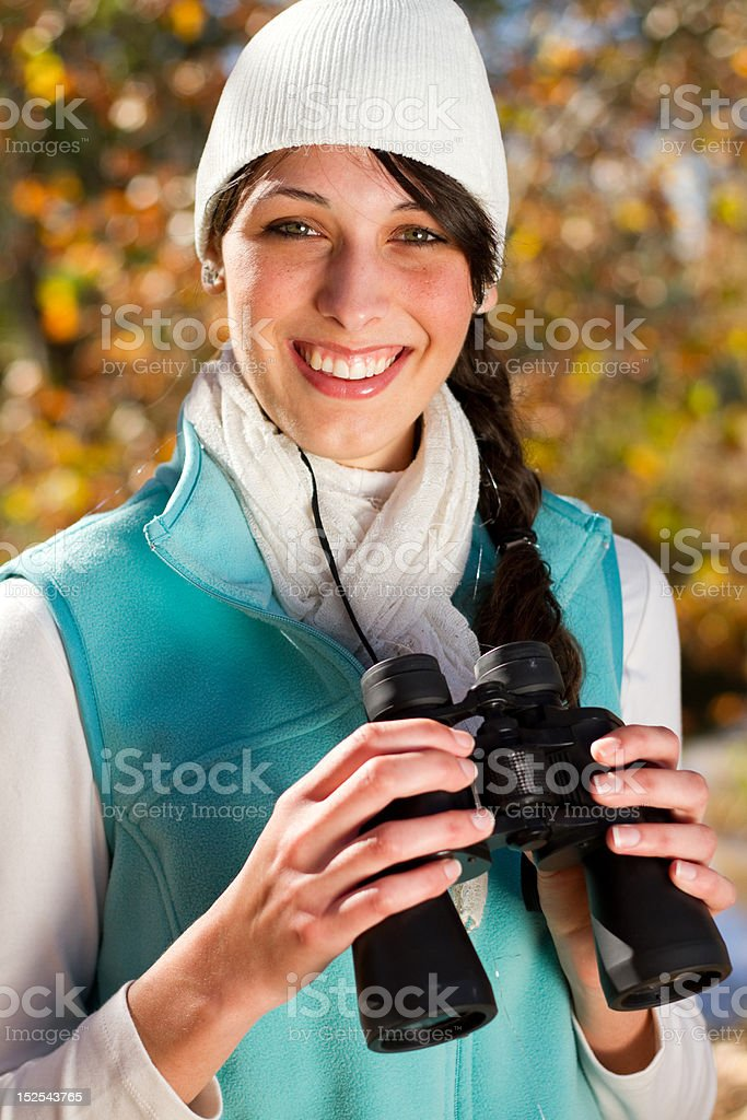 woman holding binoculars outdoors royalty-free stock photo