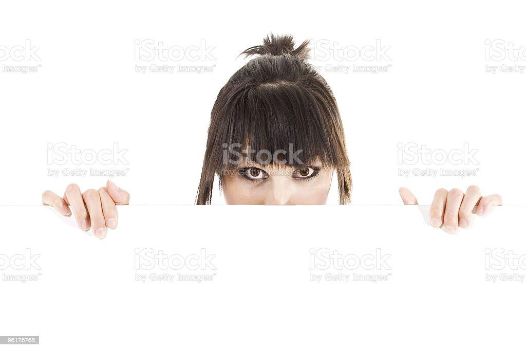 Woman holding blank billboard royalty-free stock photo
