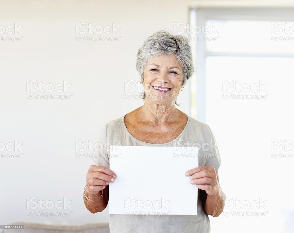 Woman holding blank sheet of paper stock photo