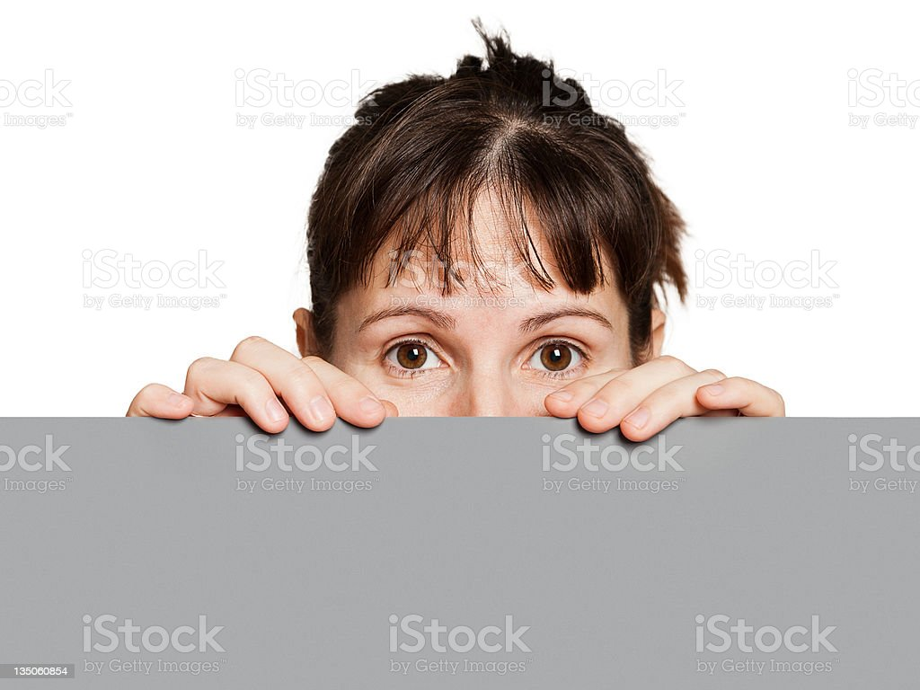 Woman holding blank sign or placard royalty-free stock photo