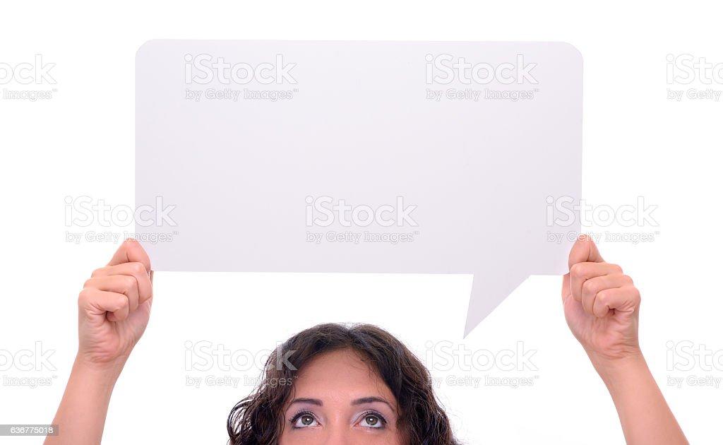 Woman holding blank speech bubble stock photo