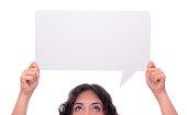 Woman holding blank speech bubble