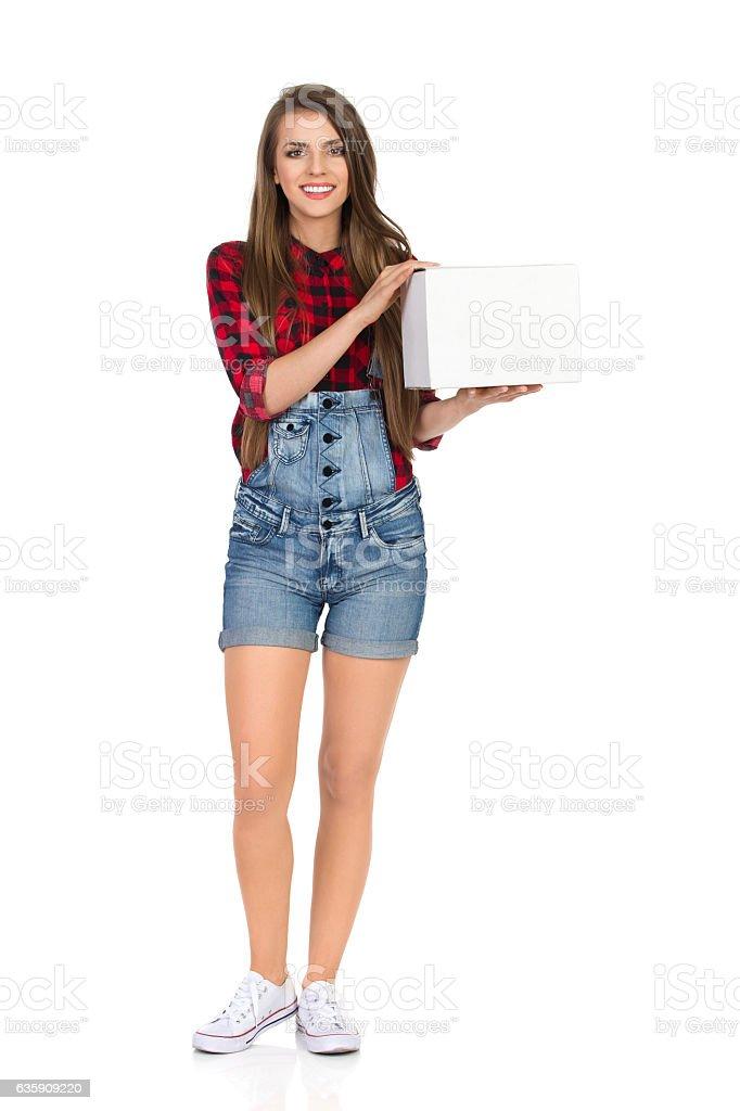 Woman Holding Blank White Box stock photo