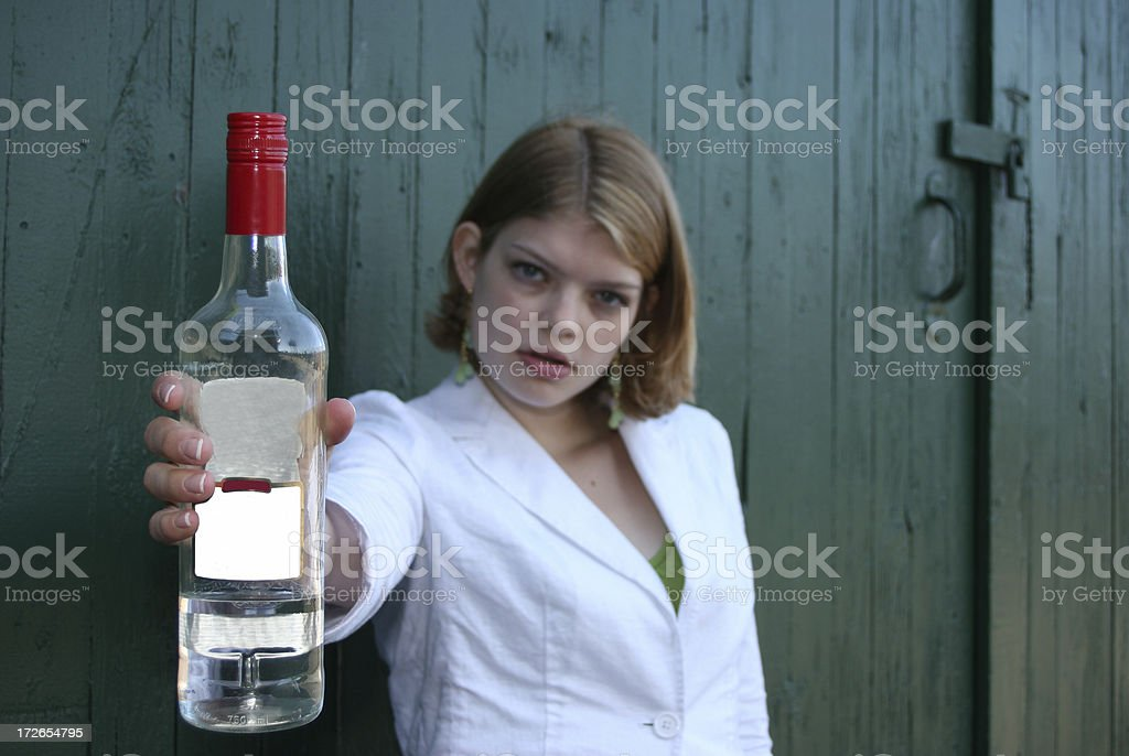 Woman Holding Bottle of Alcohol stock photo