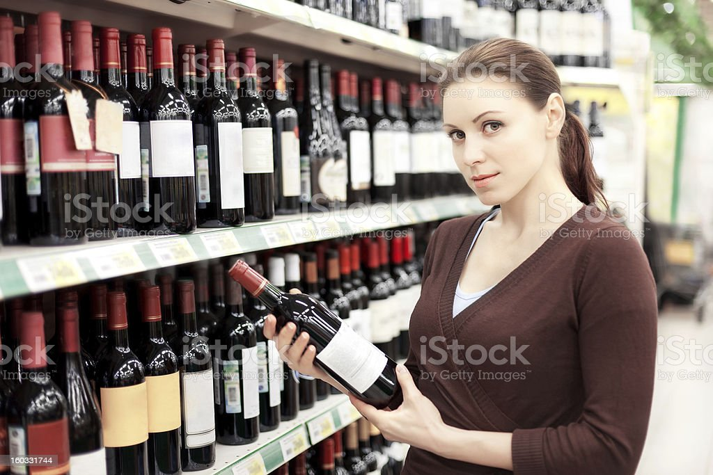 Woman Holding Bottle of Wine. stock photo