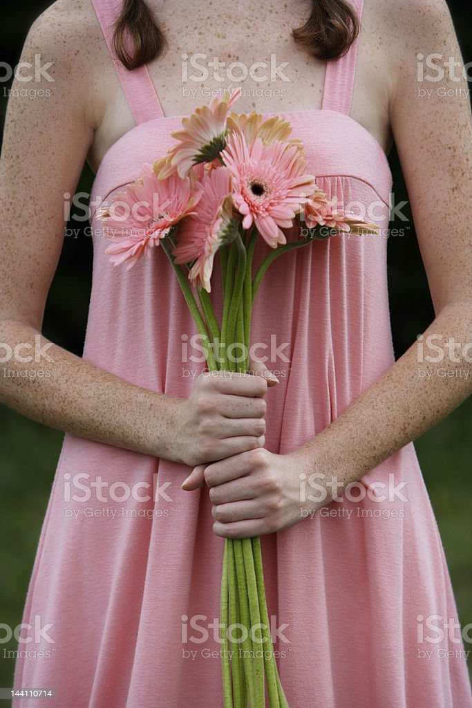 Woman holding bouquet of daisies royalty-free stock photo