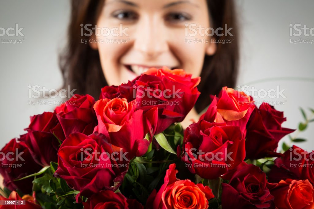 woman holding bouquet of roses stock photo