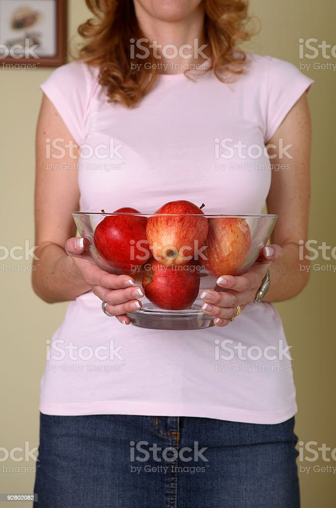 Woman holding bowl of apples royalty-free stock photo