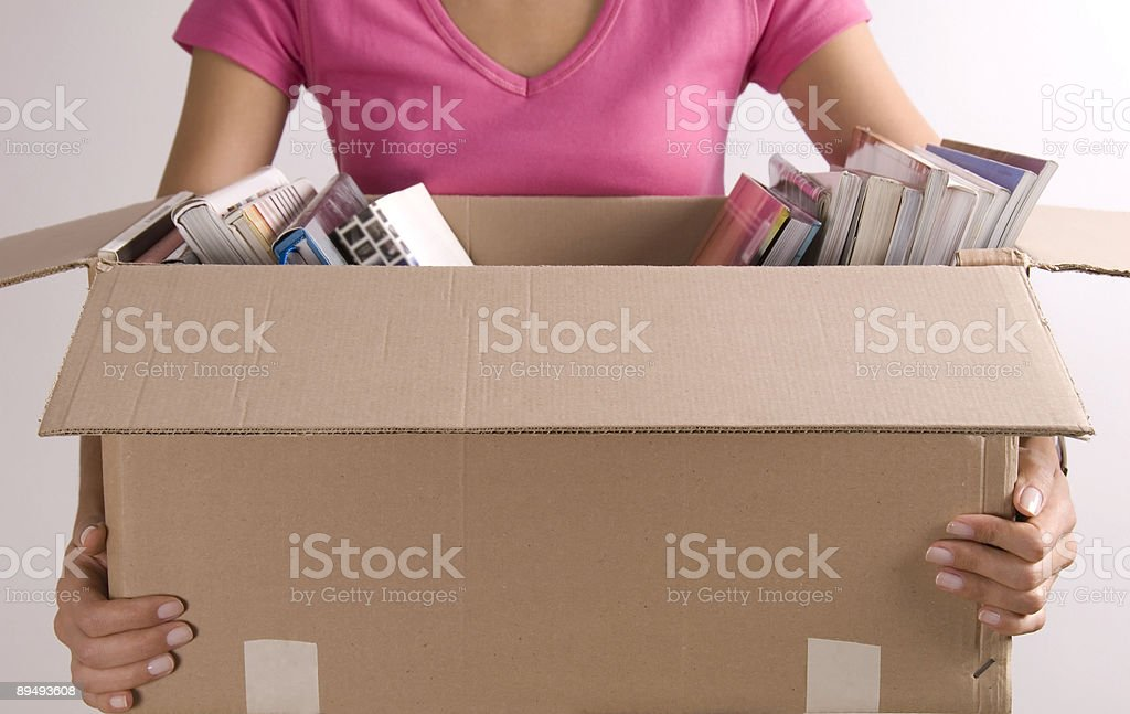 Woman Holding Box of Books royalty-free stock photo