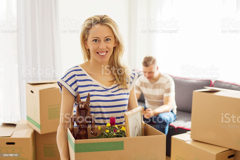 Woman holding box with objects stock photo