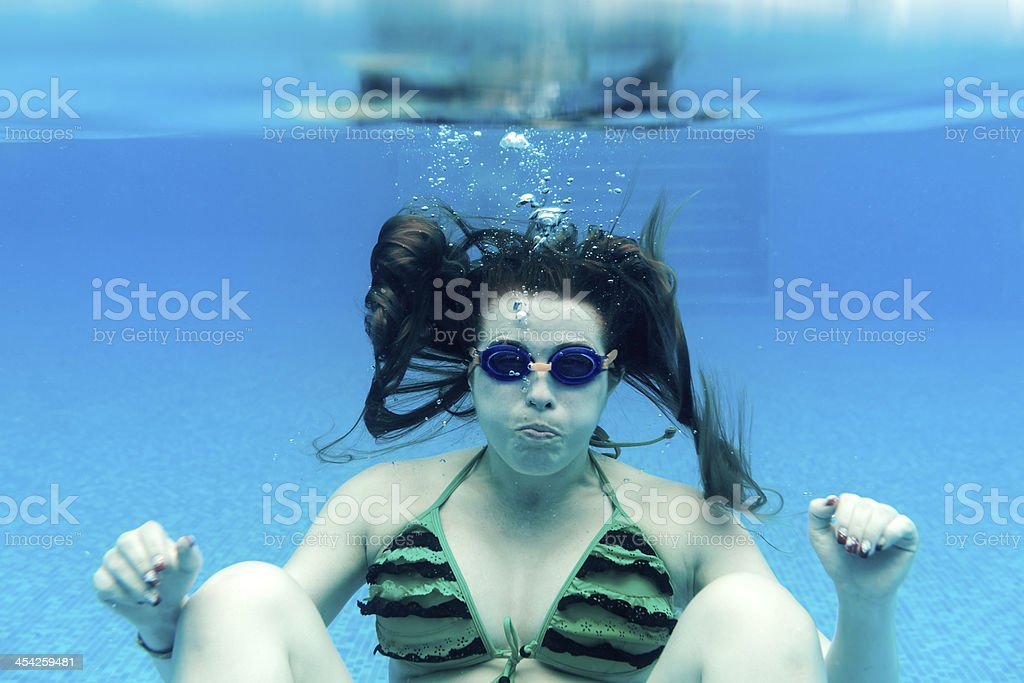 woman holding breath underwater royalty-free stock photo