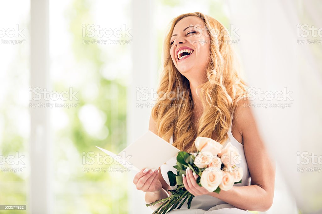 Woman holding bunch of roses stock photo