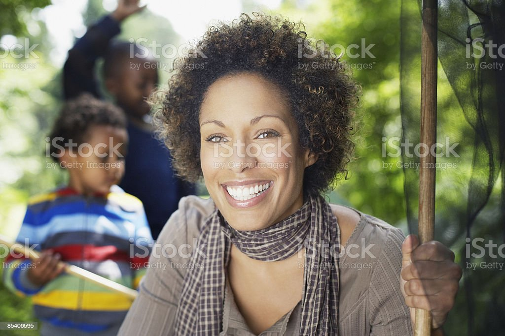 Woman holding butterfly net royalty-free stock photo