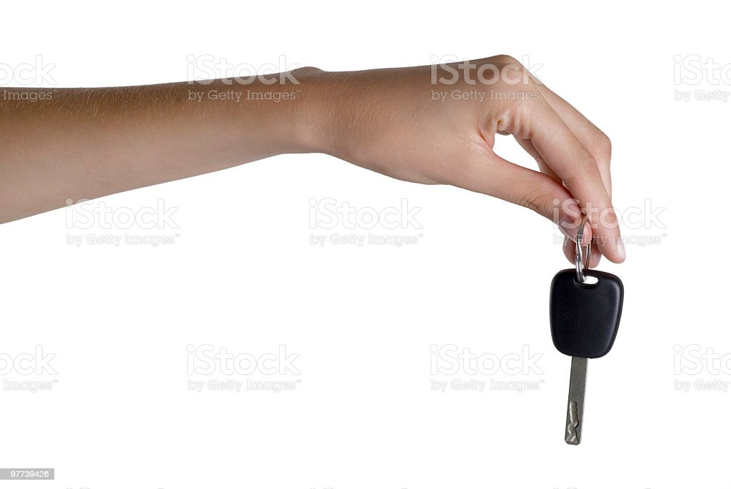 woman holding car key, close-up royalty-free stock photo