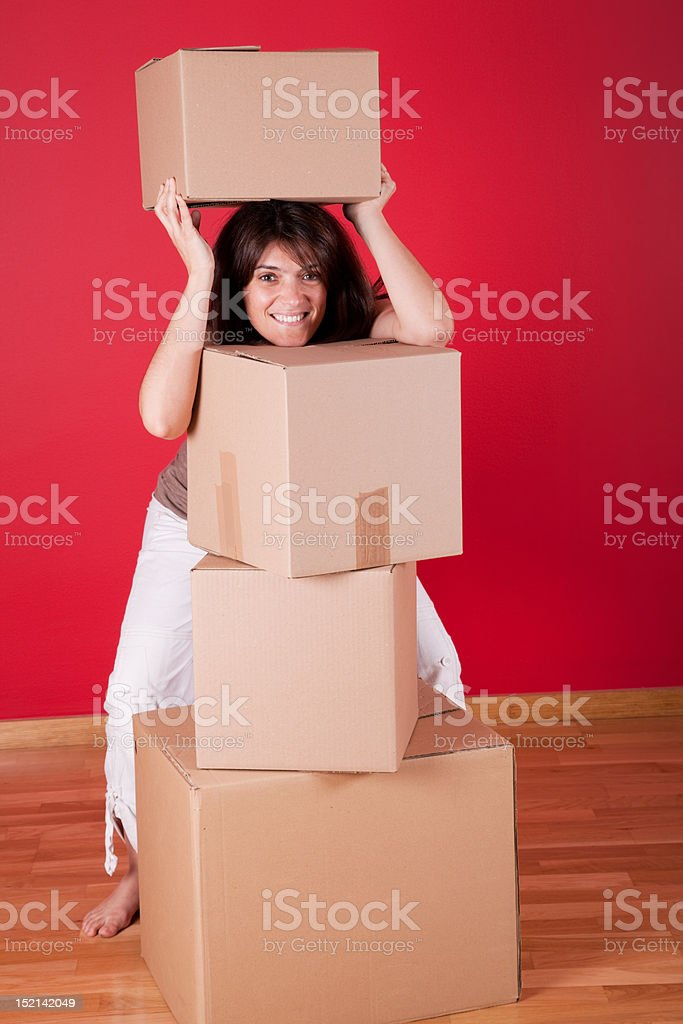 Woman holding cardboard boxes royalty-free stock photo