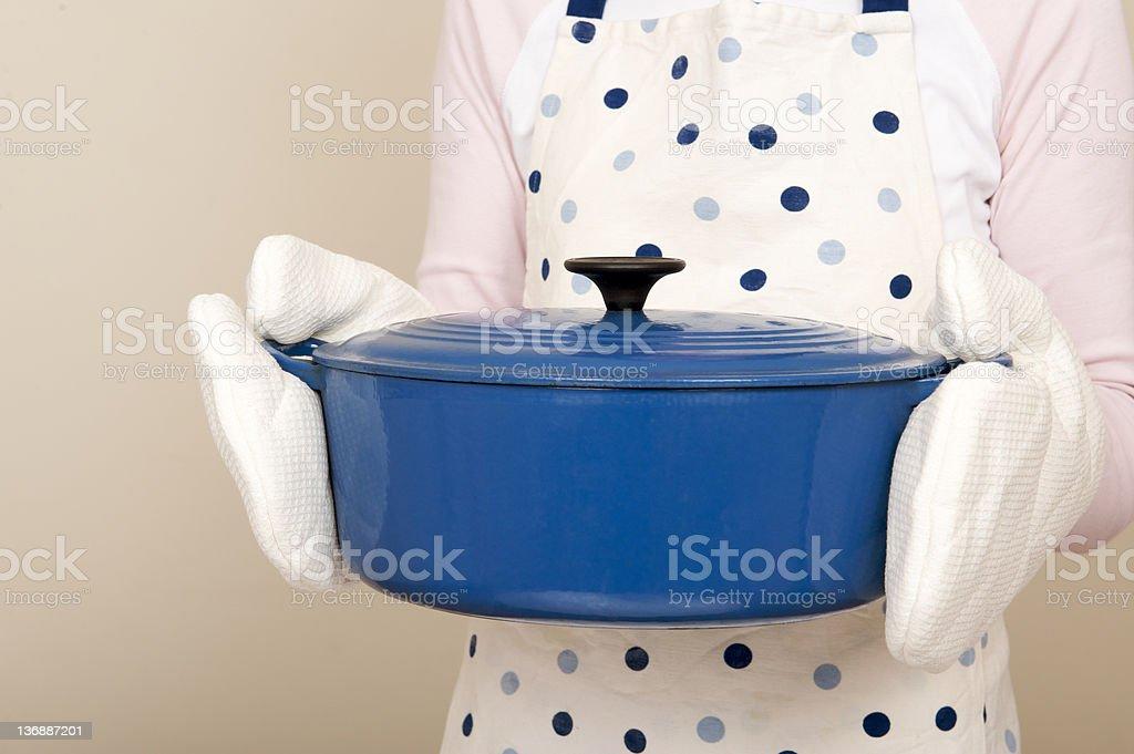 Woman holding casserole dish stock photo