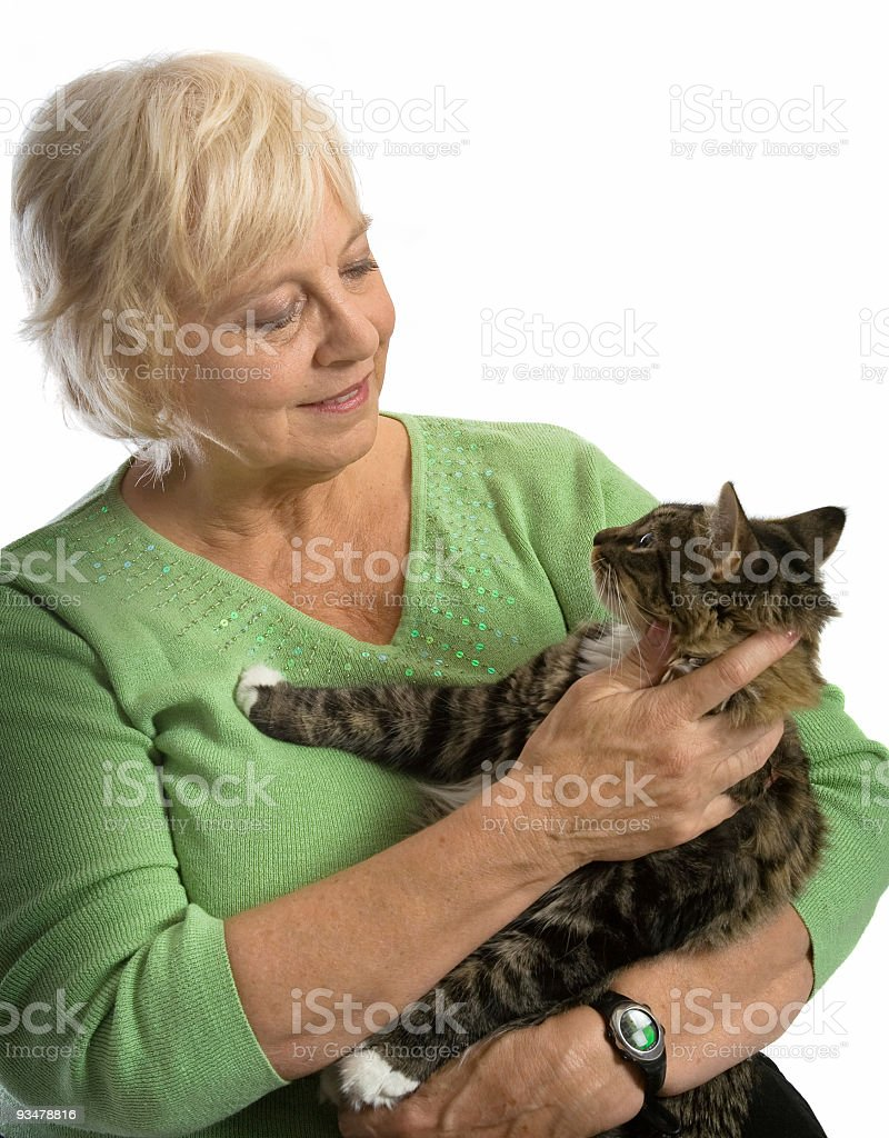 Woman holding cat royalty-free stock photo