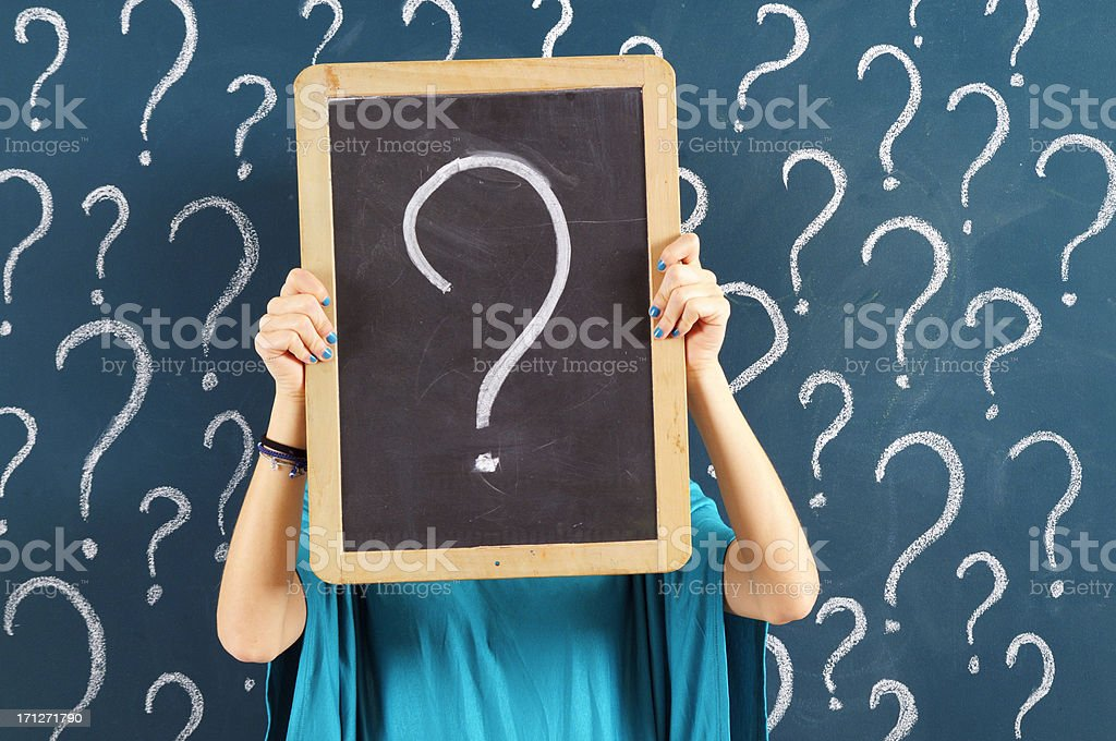 Woman holding chalkboard with question mark stock photo