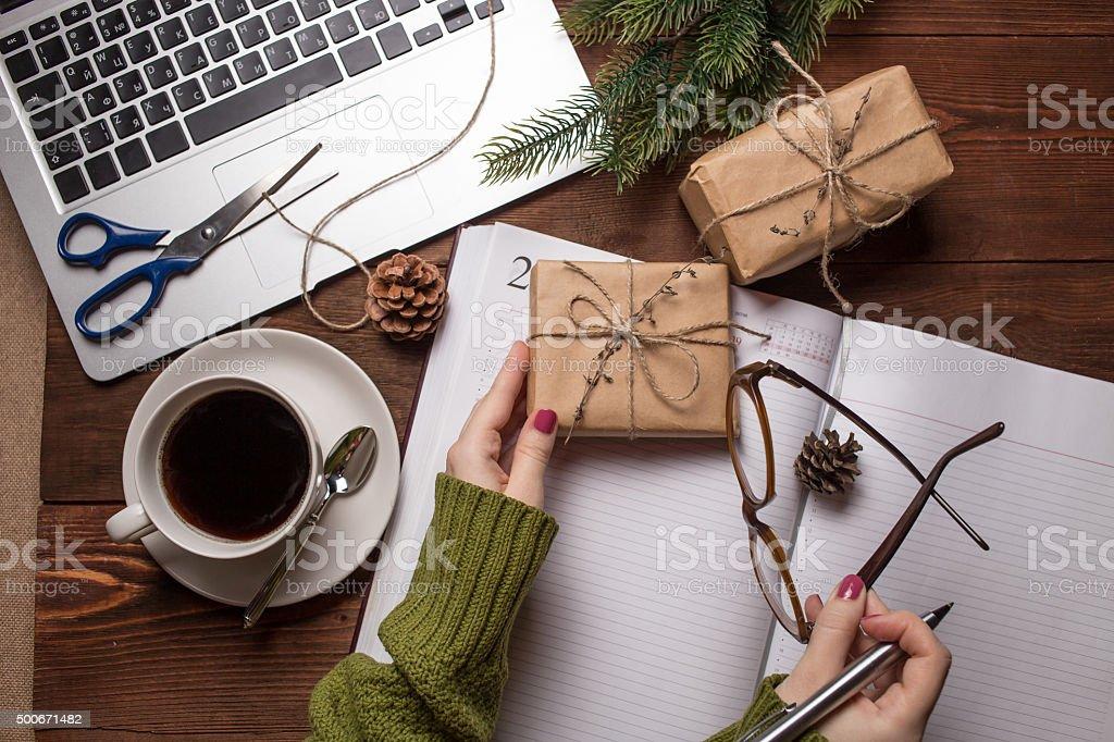 Woman holding Christmas gift stock photo