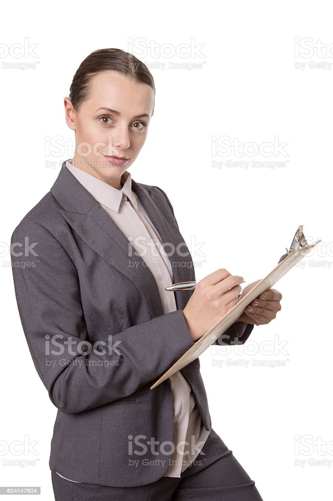 Woman holding clipboard stock photo