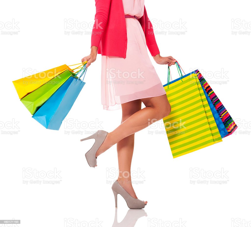 Woman holding colorful shopping bags royalty-free stock photo