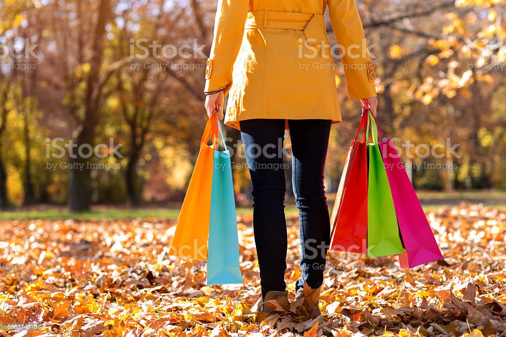 Woman holding colorful shopping bags stock photo
