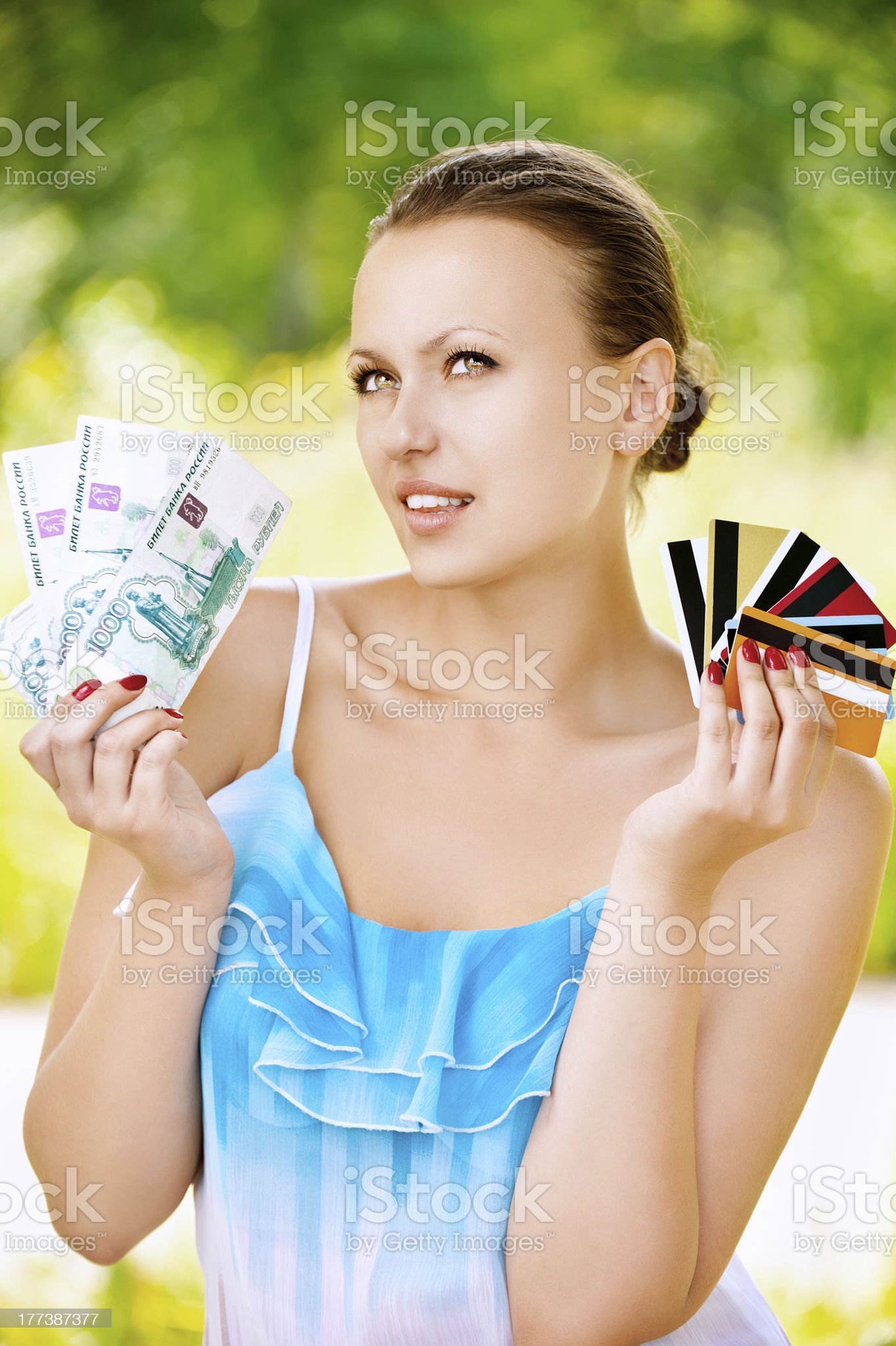 Woman holding credit cards and cash royalty-free stock photo