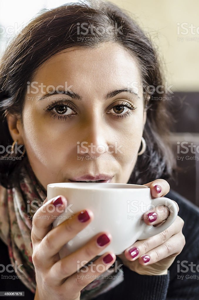 Woman holding cup of coffee stock photo