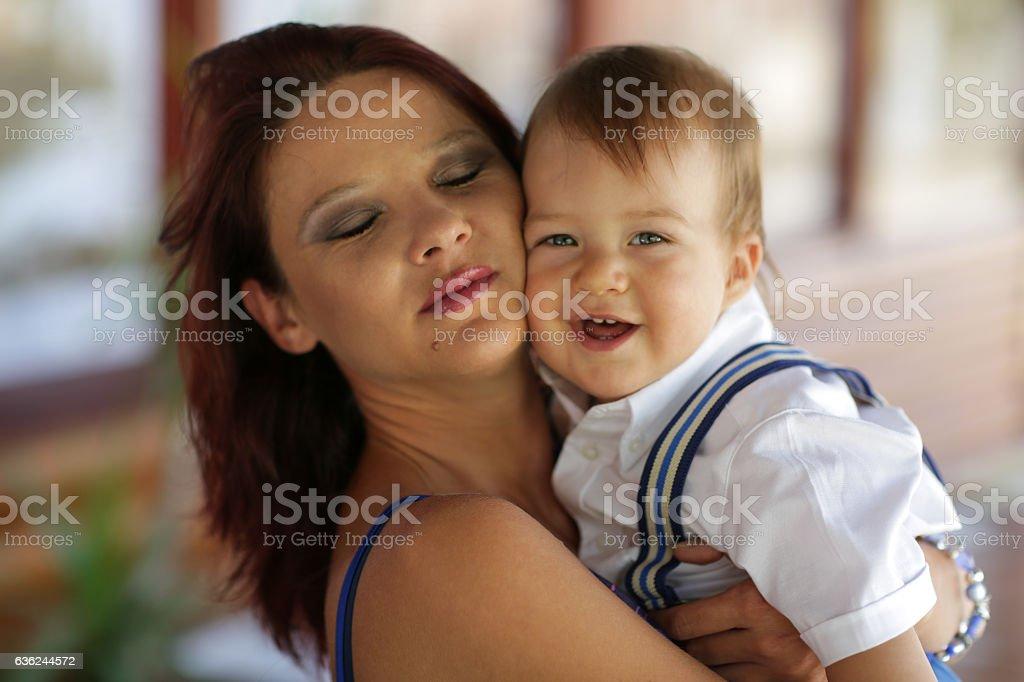 Woman holding cute baby boy stock photo