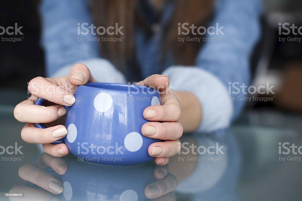 Woman holding dotted mug royalty-free stock photo
