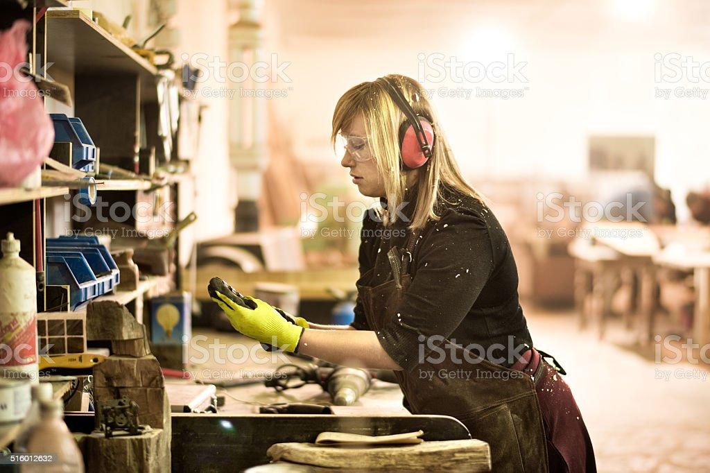 Woman holding drill bit stock photo