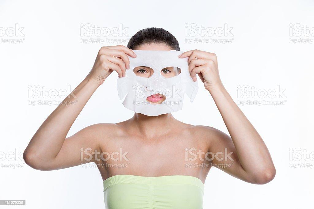 Woman holding facial mask stock photo