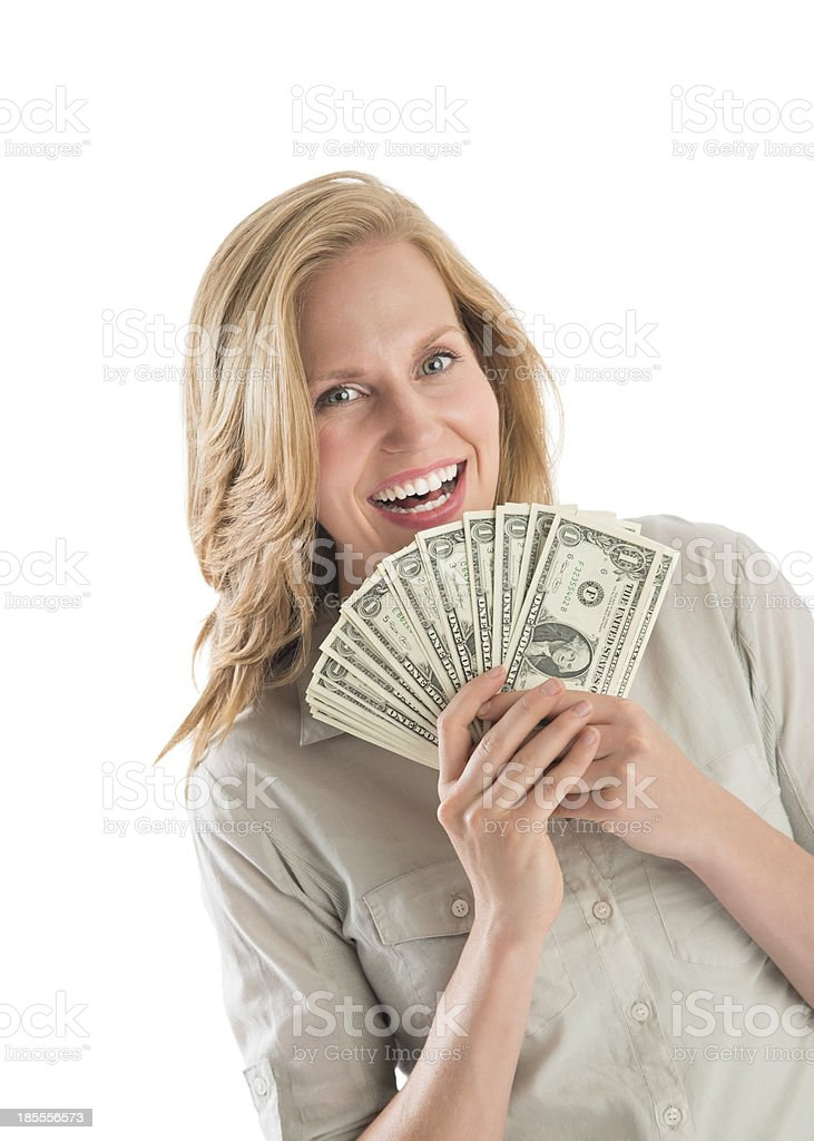 Woman Holding Fanned One Dollar Bills stock photo