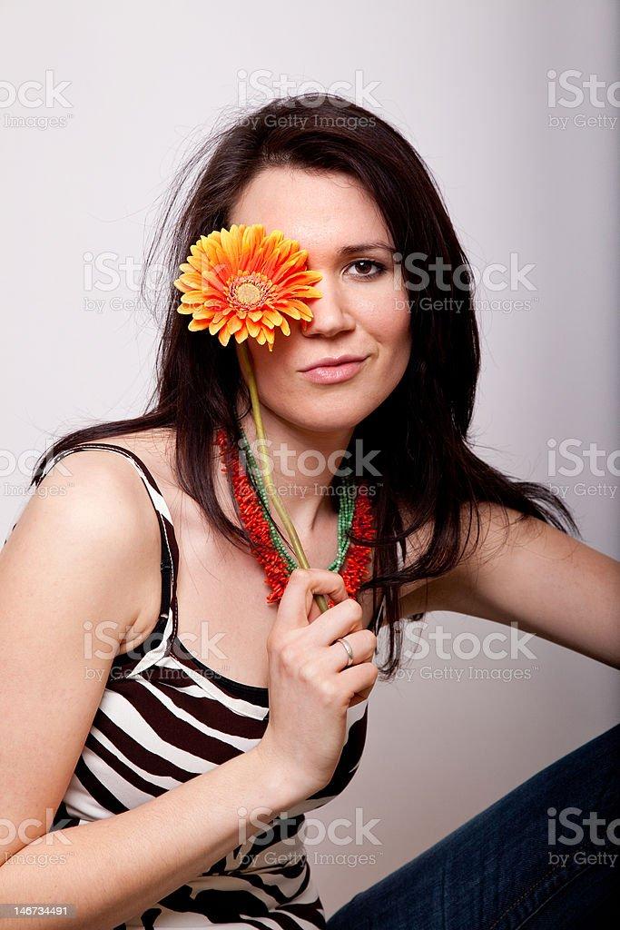 Woman holding flower stock photo