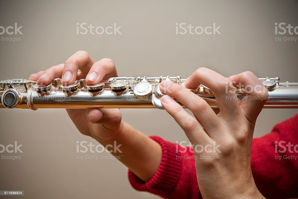 Woman Holding Flute stock photo
