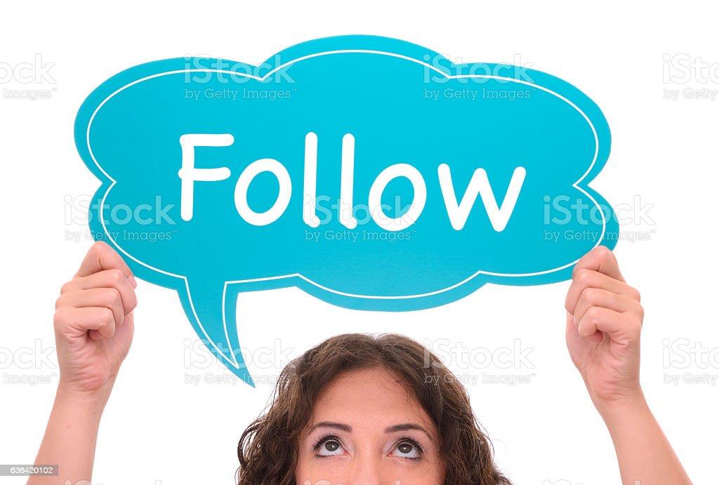 Woman holding follow sign stock photo