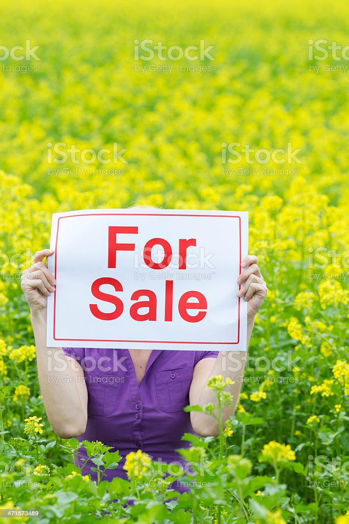 Woman Holding For Sale Sign In Front Of Face royalty-free stock photo