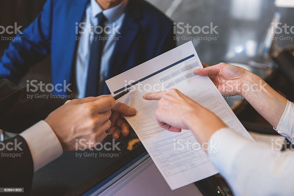 Woman holding form to fill in stock photo